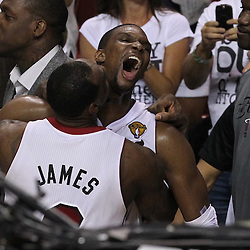 Jun 21, 2012; Miami, FL, USA; Miami Heat small forward LeBron James (6) hugs power forward Chris Bosh (1)a after winning the 2012 NBA championship at the American Airlines Arena. Miami won 121-106. Mandatory Credit: Derick E. Hingle-US PRESSWIRE