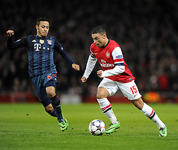 Arsenal's Alex Oxlade-Chamberlain takes the ball past Bayern Munich's Thiago Alcantara - Photo mandatory by-line: Joe Meredith/JMP - Tel: Mobile: 07966 386802 19/02/2014 - SPORT - FOOTBALL - London - Emirates Stadium - Arsenal v Bayern Munich - Champions League - Last 16 - First Leg