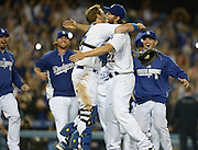 Clayton Kershaw gets a hug from catcher A.J. Ellis after he throws a no hitter. The Dodgers defeated the Colorado Rockies 8-0 at Dodger Stadium in Los Angeles, CA. 6/18/2014(Photo by John McCoy Daily News)