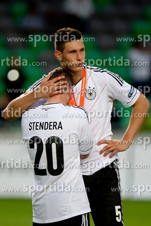 Marc Stendera of Germany and Niklas Suele of Germany after trophy ceremony after winning the UEFA European Under-17 Championship Final match between Germany and Netherlands on May 16, 2012 in SRC Stozice, Ljubljana, Slovenia. Netherlands defeated Germany after penalty shots and became European Under-17 Champion 2012. (Photo by Urban Urbanc / Sportida.com)