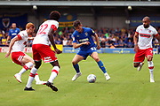 AFC Wimbledon midfielder Callum Reilly (33) surrounded by Rotherham United players during the EFL Sky Bet League 1 match between AFC Wimbledon and Rotherham United at the Cherry Red Records Stadium, Kingston, England on 3 August 2019.
