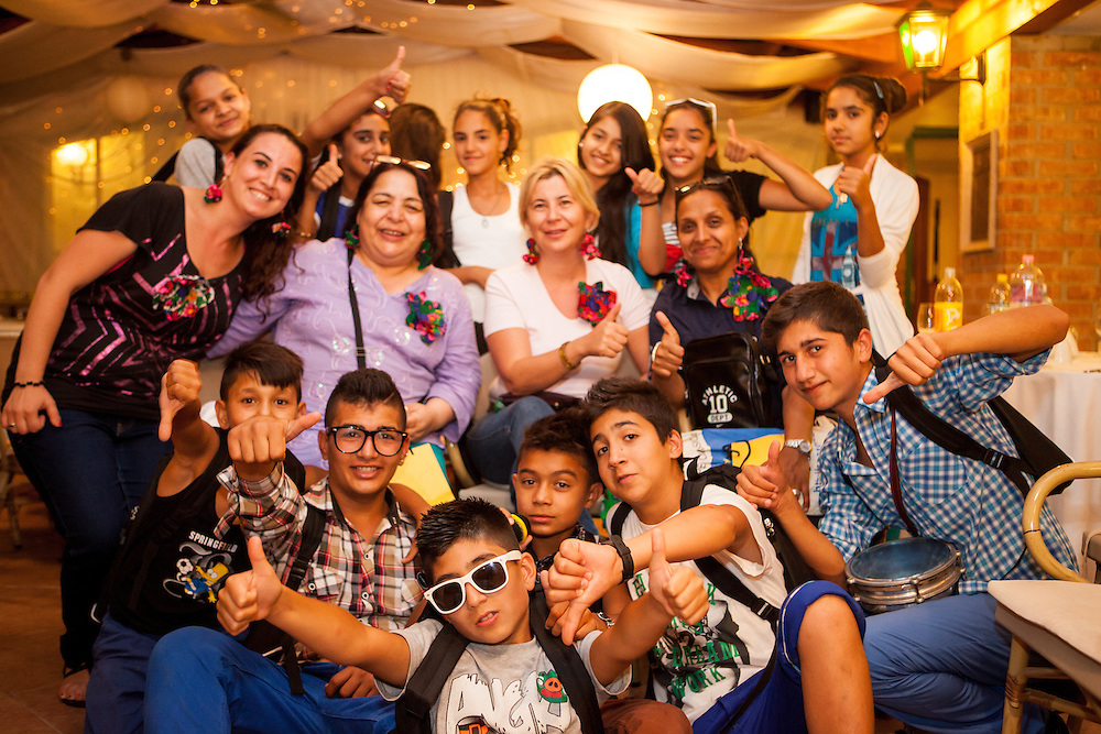 Barvalipe: The 2nd Roma Pride Summer Camp for young Roma from Central and Eastern Europe at Szentendre Island near Budapest, Hungary. Group photograph of Roma children from Mazedonia and participants during the evening celebration.