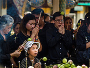 20 OCTOBER 2016 - BANGKOK, THAILAND: People mourning the death of the late Bhumibol Adulyadej, the King of Thailand, pray at Wat Phra Kaew, the most important Buddhist temple in Thailand. The King died Oct. 13, 2016. He was 88. His death came after a period of failing health. Bhumibol Adulyadej was born in Cambridge, MA, on 5 December 1927. He was the ninth monarch of Thailand from the Chakri Dynasty and is also known as Rama IX. He became King on June 9, 1946 and served as King of Thailand for 70 years, 126 days. He was, at the time of his death, the world's longest-serving head of state and the longest-reigning monarch in Thai history.       PHOTO BY JACK KURTZ