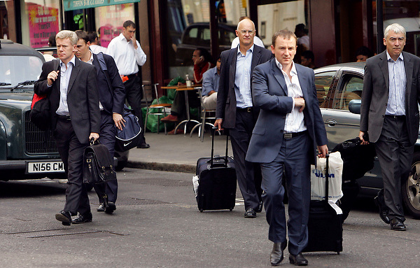business colleagues on a business trip, liverpool st Station. 11/08/05 by Neville Elder