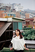 Anne Desmarais on the roof top of the building she is living  in Seoul, South Korea.