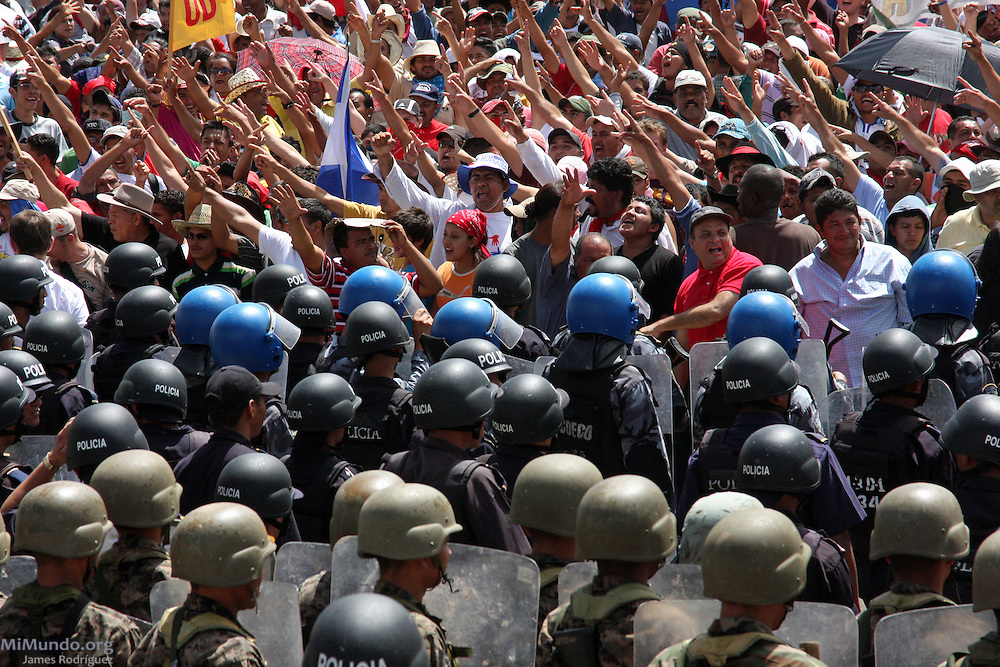 """Tegucigalpa, Honduras. July 4th, 2009. Thousands of people arrive to Toncontin Airport as a sign of protest to the Coup d'Etat that forcibly removed President Manuel """"Mel"""" Zelaya on June 28th, 2009."""