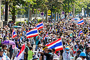 01 DECEMBER 2013 - BANGKOK, THAILAND: Protestors gather on Phitsanulok Road in Bangkok before marching towards Thai riot police positions. Thousands of anti-government Thais confronted riot police at Phanitchayakan Intersection, where Rama V and Phitsanoluk Roads intersect, next to Government House (the office of the Prime Minister). Protestors threw rocks, cherry bombs, small explosives and Molotov cocktails at police who responded with waves of tear gas and chemical dispersal weapons. At least four people were killed at a university in suburban Bangkok when gangs of pro-government and anti-government demonstrators clashed. This is the most serious political violence in Thailand since 2010.    PHOTO BY JACK KURTZ