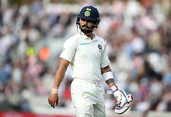 India's Virat Kohli leaves the field after being dimissed by England's Stuart Broad during the test match at The Kia Oval, London.