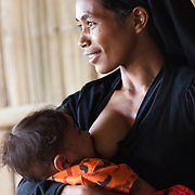 A breast feeding mother at a Mother Support Group session where breast feeding mothers with 4 months plus babies learn about food supplements. Infant mortality rates are very high in Timor-Leste and one of the reasons for that is poor nutrition. Alola advocate breast feeding till at least two years old and teach women about nutritious supplements such as boiled and mashed rice w vegetables and eggs.  Fundasaun Alola is a not for profit non government organization operating in Timor Leste to improve the lives of women and children. Founded in 2001 by the then First Lady, Ms Kirsty Sword Gusmao, the organization seeks to nurture women leaders and advocate for the rights of women.