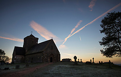 © Licensed to London News Pictures. 05/01/2017. Chilworth UK.  Aircraft trails are seen in the early morning sky above St Martha's church on the North Downs.  A continuing cold spell has seen temperatures as low as -6 in some areas. Photo credit: Peter Macdiarmid/LNP