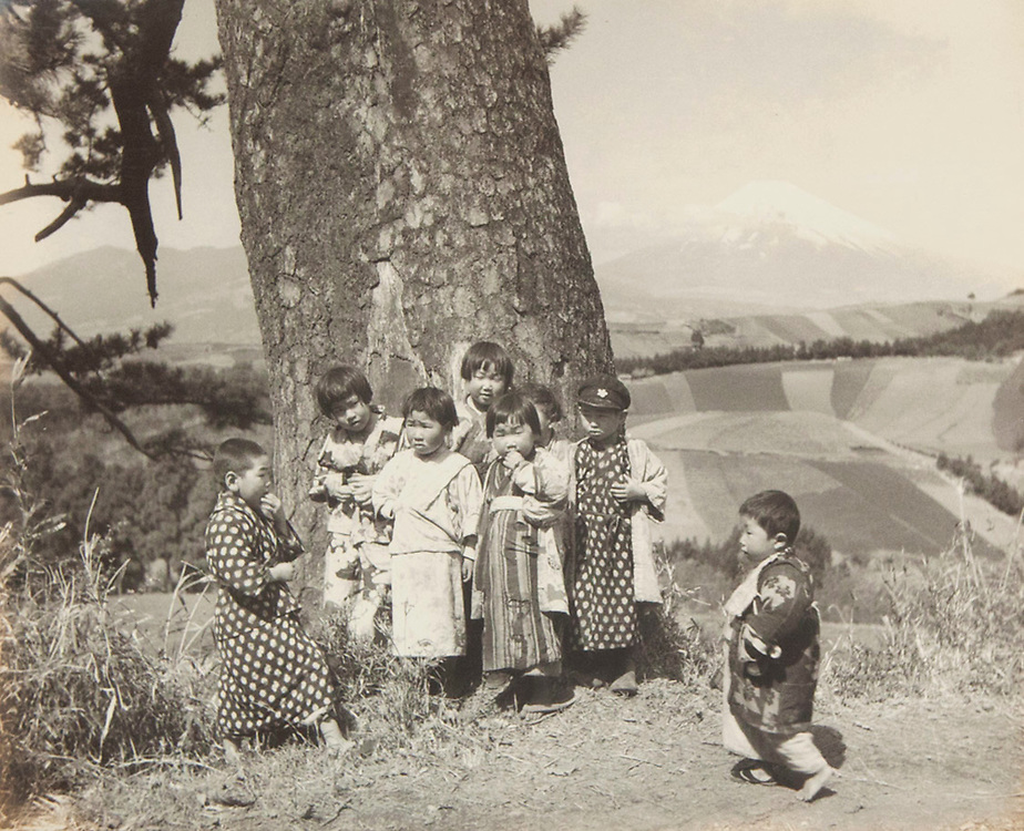 Okada Koyo<br /> Elementary students from the village of Mitsuya Shinden on the Tokaido Road<br /> Date: 1940s<br /> <br /> One of the very few Okada images of Mt. Fuji with the primary focus being people.<br /> <br /> Description: Rare image by Okada showing people prominently posed in the foreground. This photo was taken at the village of Mitsuda Shingen, in Shizuoka Prefecture, which is on the old and historic Tokaido Road. In the book &ldquo;Mt. Fuji&rdquo;, by Okada Koyo, Hobundo Publishing, Tokyo, 1964, he writes about this location:<br /> <br /> &ldquo;Mitsuya Shinden is a village on the highway between Mishima and Hakone about 20 minutes by car from Mishima. If you turn left off the highway and go beyond the farmhouses that line it, you come to the broad fields seen here. Since the place is conveniently located, I usually go there about once a month, and the rhythmical changes in the appearance of the fields fascinates me&rdquo;.<br /> <br /> Vintage or near vintage, double weight, gelatin silver print, with smooth semi-matte surface, unsigned.<br /> <br /> Condition: Good with some minor color shifts at the edges. There is also a small crease, about 10 mm in length in the lower left corner. The print comes matted in an archival mat board.<br /> <br /> Size: 10 1/4 in. x 8 1/4 in. (260 mm x 210 mm).<br /> <br /> Price: &yen;150,000 JPY<br /> <br /> <br /> <br /> <br /> <br /> <br /> <br /> <br /> <br /> <br /> <br /> <br /> <br /> <br /> <br /> <br /> <br /> <br /> <br /> <br /> <br /> <br /> <br /> <br /> <br /> <br /> <br /> <br /> <br /> <br /> <br /> <br /> <br /> <br /> <br /> <br /> <br /> <br /> <br /> <br /> <br /> <br /> <br /> <br /> <br /> <br /> <br /> <br /> <br /> <br /> <br /> <br /> <br /> <br /> <br /> <br /> <br /> <br /> <br /> <br /> <br /> <br /> <br /> <br /> <br /> <br /> <br /> <br /> <br /> <br /> <br /> <br /> <br /> <br /> <br /> <br /> <br /> <br /> <br /> <br /> <br /> <br /> .