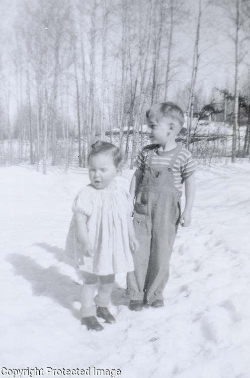 Berncie & Brian looking for a coat. Owakonze circa 1949.