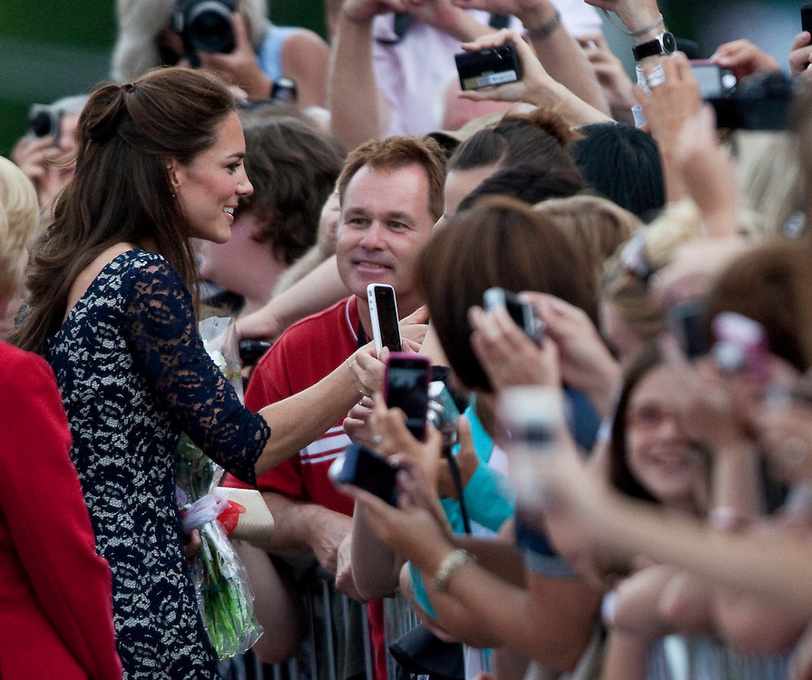 Catherine the Duchess of Cambridge greets well wishers following a wreath laying ceremony at the National War Memorial in Ottawa, Ontario, June 30, 2011, the first stop on her nine-day tour of Canada with her husband Prince William, their first official foreign trip as husband and wifeAFP PHOTO/GEOFF ROBINS