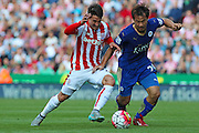 Stoke City's Bojan Krkic and Leicester City's Shinji Okazaki challenge for the ball during the Barclays Premier League match between Stoke City and Leicester City at the Britannia Stadium, Stoke-on-Trent, England on 19 September 2015. Photo by Aaron Lupton.