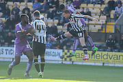 Notts County defender Gill Swerts and Plymouth Argyle defender Curtis Nelson battle for the header during the Sky Bet League 2 match between Notts County and Plymouth Argyle at Meadow Lane, Nottingham, England on 11 October 2015. Photo by Simon Davies.