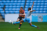 Bradford City defender Anthony McMahon (29) plays the ball down the line during the EFL Sky Bet League 1 match between Coventry City and Bradford City at the Ricoh Arena, Coventry, England on 11 March 2017. Photo by Simon Davies.
