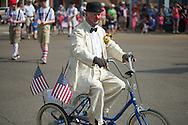 John Arrechea rides in the 4th of July parade in Oxford, Miss. on Thursday, July 4, 2013.