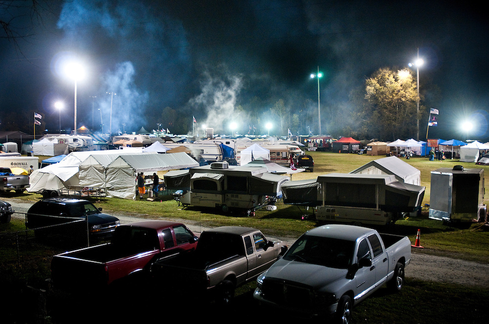 "Smoke rising over ""The Hollow"", the night before competition day at the Jack Daniels Invitational Barbecue 2012. This is where the contestants live and work during the competition...Photographer: Chris Maluszynski /MOMENT"