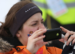 Woman taking pictures with iPhone at Ladies` Pursuit 7,5 km Classic + 7,5 km Free at FIS Nordic World Ski Championships Liberec 2008, on February 21, 2009, in Vestec, Liberec, Czech Republic. (Photo by Vid Ponikvar / Sportida)