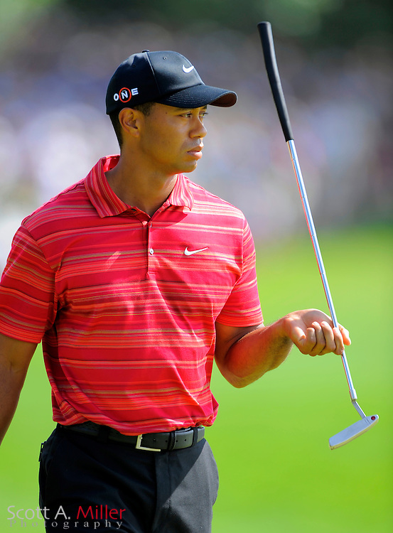Aug 16, 2009; Chaska, MN, USA; Tiger Woods (USA) twirls his putter on the 7th green during the final round of the 2009 PGA Championship at Hazeltine National Golf Club.  ©2009 Scott A. Miller