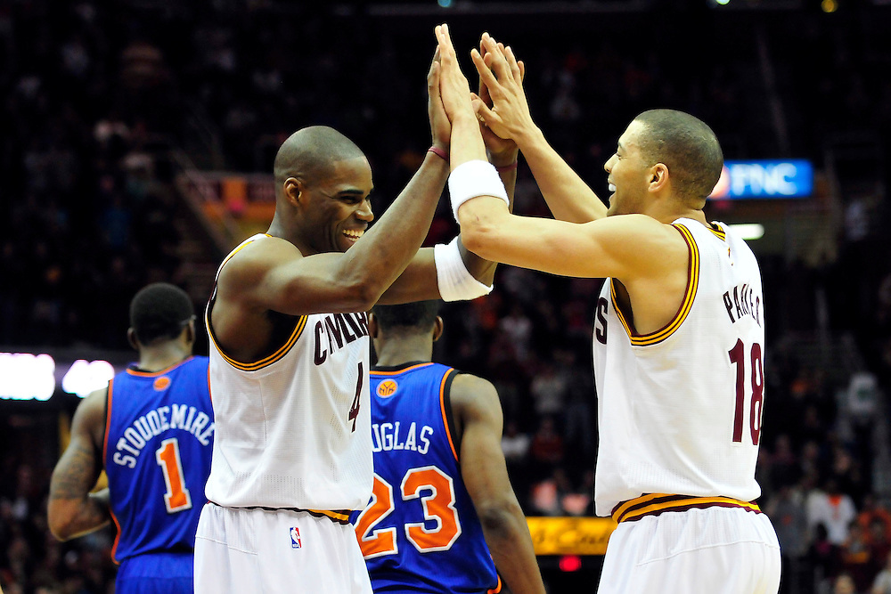 Feb. 25, 2011; Cleveland, OH, USA; Cleveland Cavaliers power forward Antawn Jamison (4) and shooting guard Anthony Parker (18) celebrate during the final seconds of the fourth quarter against the New York Knicks at Quicken Loans Arena. The Cavaliers beat the Knicks 115-109. Mandatory Credit: Jason Miller-US PRESSWIRE