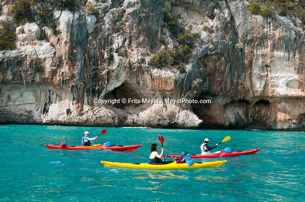 Gulf of Orosei, Sardinia, Italy, September 2012. Kayaking through the gulf of Orosei gives a totally different view on the steep cliffs. Far away from the touristic Costa Esmeralde lies the wildest coastline of Sardinia. The turquoise waters of the Gulf of Orosei are lined by steep limestone cliffs. The wild rocky hinterland, that is home to shepherds who herd their sheep through the scrubby bushes, oak and juniper trees, offers some of the most spectacular hiking in Italy. Photo by Frits Meyst/Adventure4ever.com