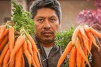"""Gilroy farmer Jose Nunez at the Saturday Market in Calistoga  """"We get up at 4 AM and drive three hours to get here each Saturday morning.""""  citlallin.n.2023@ceibaprep.org"""
