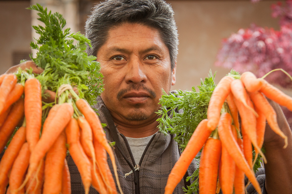 "Gilroy farmer Jose Nunez at the Saturday Market in Calistoga  ""We get up at 4 AM and drive three hours to get here each Saturday morning.""  citlallin.n.2023@ceibaprep.org"