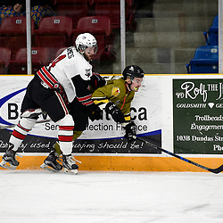"TRENTON, ON  - MAY 4,  2017: Canadian Junior Hockey League, Central Canadian Jr. ""A"" Championship. The Dudley Hewitt Cup. Game 5 between Powassan Voodoos and the Georgetown Raiders. Griffin James #4 of the Georgetown Raiders makes the hit on Shane Beaulieu #7 of the Powassan Voodoos during the second period.<br /> (Photo by Andy Corneau / OJHL Images)"
