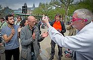 AMSTERDAM - Abulkasim Al-Jaberi  met rechts Frank Buis .  Abulkasim Al-Jaberi spreek tijdens een demonstratie op het Museumplein. De actie-groep Fuck Racisme - Fuck de Koning protesteert tegen de mogelijke vervolging van de activist Abulkasim Al-Jaberi, die tijdens een demonstratie tegen Zwarte Piet Fuck de Koning riep COPYRIGHT ROBIN UTRECHT
