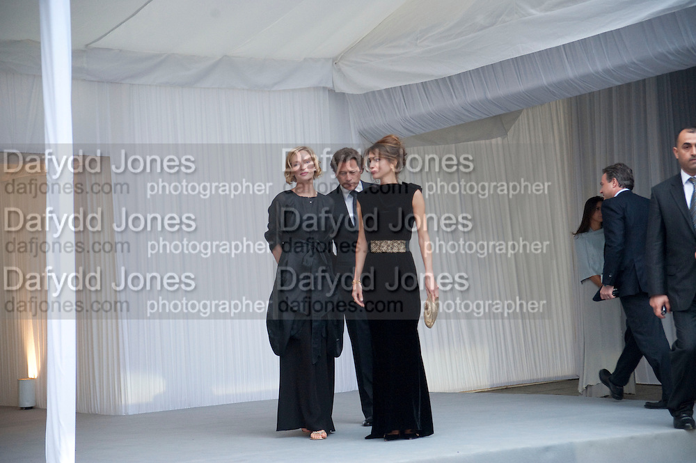 UMA THURMAN; QUEEN RANIA OF JORDAN; ARKI BUSSON; N, Ark- Absolute Return for Kids. Fundraiser at Waterloo Euroster terminal. London. 13 May 2010. -DO NOT ARCHIVE-© Copyright Photograph by Dafydd Jones. 248 Clapham Rd. London SW9 0PZ. Tel 0207 820 0771. www.dafjones.com.