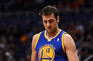 Dec 15, 2013; Phoenix, AZ, USA; Golden State Warriors center Andrew Bogut (12) reacts on the court against the Phoenix Suns in the first half at US Airways Center. The Suns defeated the Warriors 106-102. Mandatory Credit: Jennifer Stewart-USA TODAY Sports
