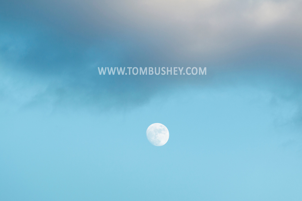 Chester, New York - The moon shines below clouds in the afternoon sky on Jan.21, 2016.