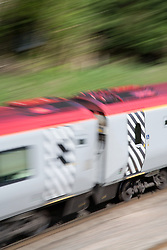 Virgin Cross Country passenger train travelling between GoringonThames and Reading,