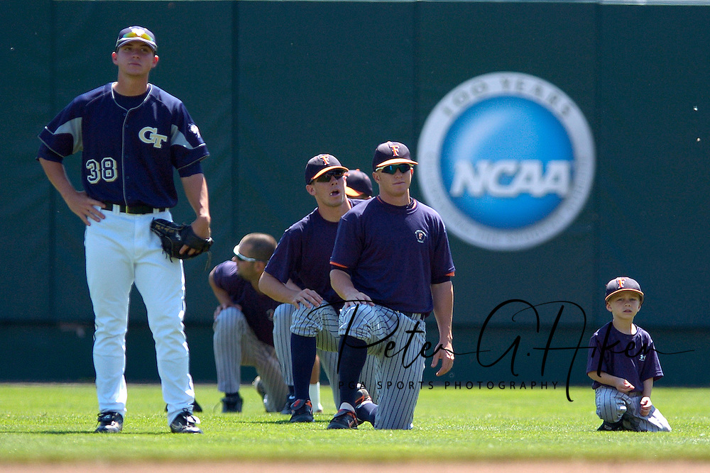 Georgia Tech's Brad Rulon (38) stands in the outfield with Cal State Fullerton players, during batting practice before game five of the College World Series at Rosenblatt Stadium in Omaha, Nebraska, June 18, 2006.