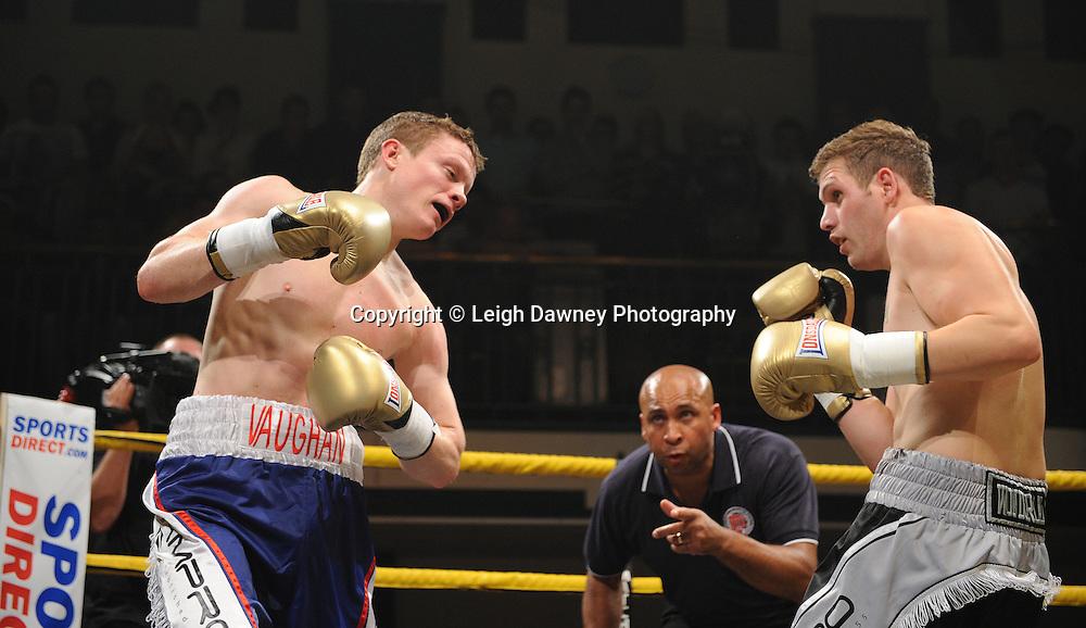 Peter Vaughan (blue/white shorts) defeats Wayne Goddard at Quarter Final Two  - The Light Middleweights II. York Hall, Bethnal Green, London, UK. 15th September 2011. Photo credit: © Leigh Dawney.