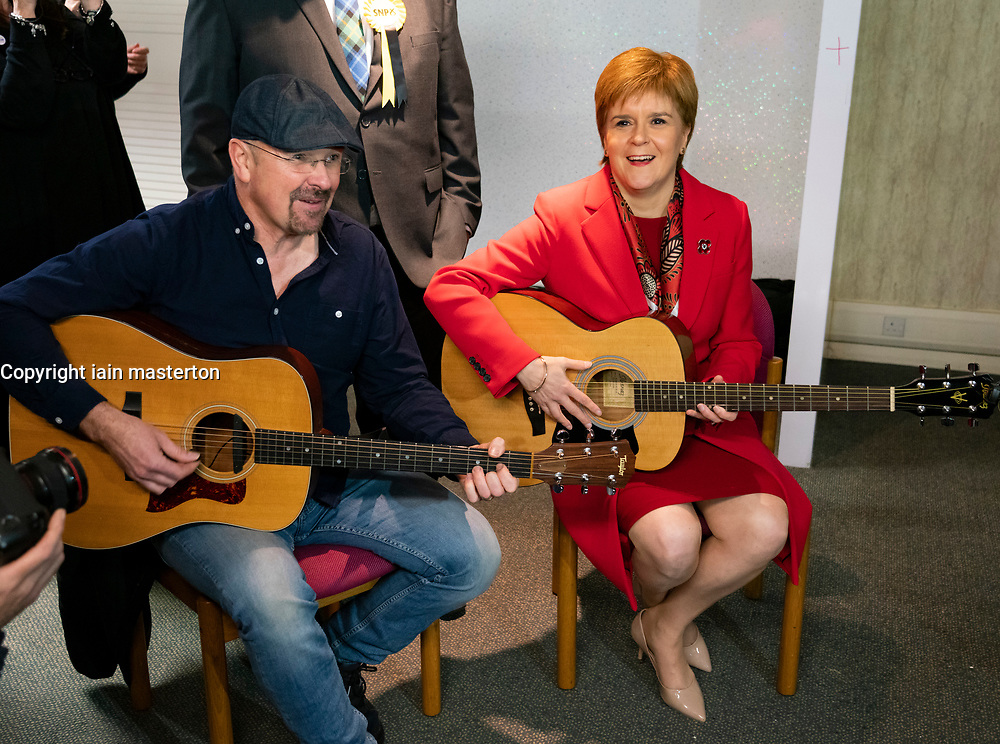 Dalkeith, Scotland, UK. 5th November 2019. First Minister Nicola Sturgeon joined Owen Thompson, SNP candidate for Midlothian, to campaign in Dalkeith at the One Dalkeith Community Hub where she met local artists and musicians. Pic; Nicola Sturgeon took part in a guitar jamming session with local musicians. Iain Masterton/Alamy Live News.