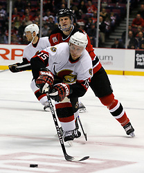 Apr 3, 2007; East Rutherford, NJ, USA; Ottawa Senators right wing Dany Heatley (15) skates past New Jersey Devils center Erik Rasmussen (10) during the second period at Continental Airlines Arena in East Rutherford, NJ.