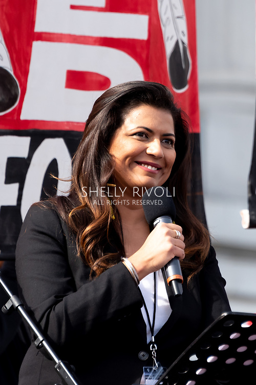 San Francisco, USA. 19th January, 2019. The Women's March San Francisco begins with a rally at Civic Center Plaza in front of City Hall. Comedian and actor Mona Shaikh, the first Pakistani female comedian to headline Hollywood Improv, was the Master of Ceremonies at the San Francisco Rally. Credit: Shelly Rivoli/Alamy Live News