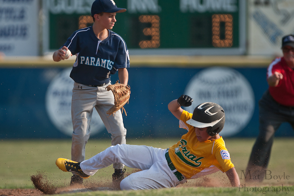 Erial's  Anthony Dimartino slides into second during a force out in an opening round game of the state tournament held in Williamstown on Friday.
