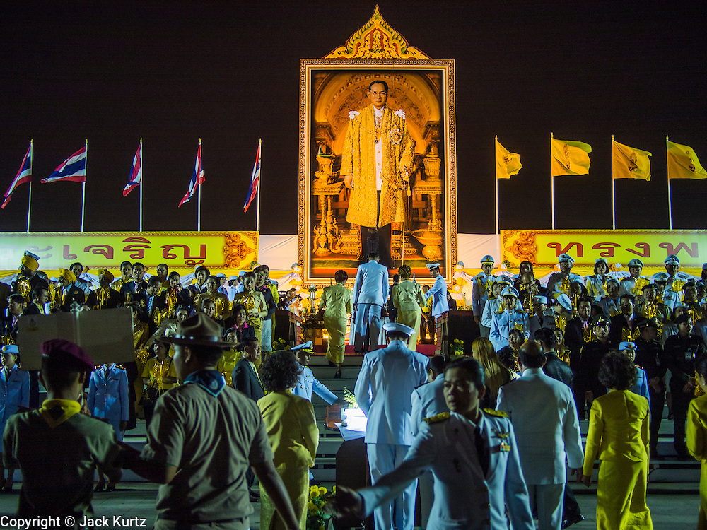 05 DECEMBER 2013 - BANGKOK, THAILAND: The celebration of the birthday of the King of Thailand. Thais observed the 86th birthday of Bhumibol Adulyadej, the King of Thailand, their revered King on Thursday. They held candlelight services throughout the country. The political protests that have gripped Bangkok were on hold for the day, although protestors did hold their own observances of the holiday. Thousands of people attended the government celebration of the day on Sanam Luang, the large public space next to the Grand Palace in Bangkok.     PHOTO BY JACK KURTZ
