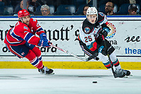 KELOWNA, BC - JANUARY 31:  Eli Zummack #29 of the Spokane Chiefs stick checks Tyson Feist #25 of the Kelowna Rockets as he skates with the puck from behind the net during third period at Prospera Place on January 31, 2020 in Kelowna, Canada. (Photo by Marissa Baecker/Shoot the Breeze)
