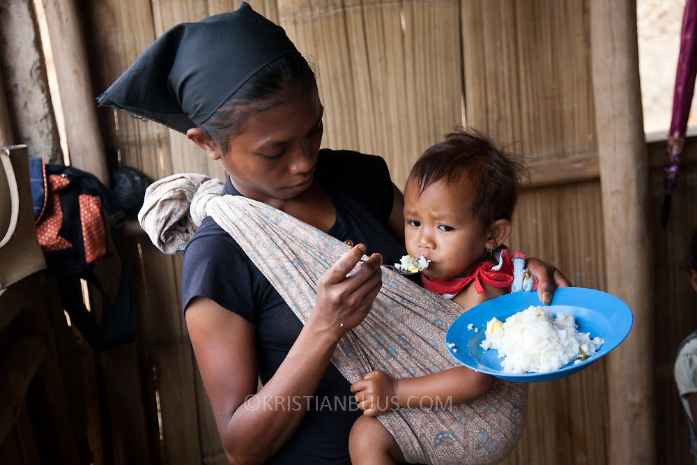 Food workshop Billum Hatu, hamlet of Madabenu. Aidiu district. Food presented at a Mother Support Group session where breast feeding mothers with 4 months plus babies learn about food supplements. Infant mortality rates are very high in Timor-Leste and one of the reasons for that is poor nutrition.with 4 months plus babies learn about food supplements. Infant mortality rates are very high in Timor-Leste and one of the reasons for that is poor nutrition.