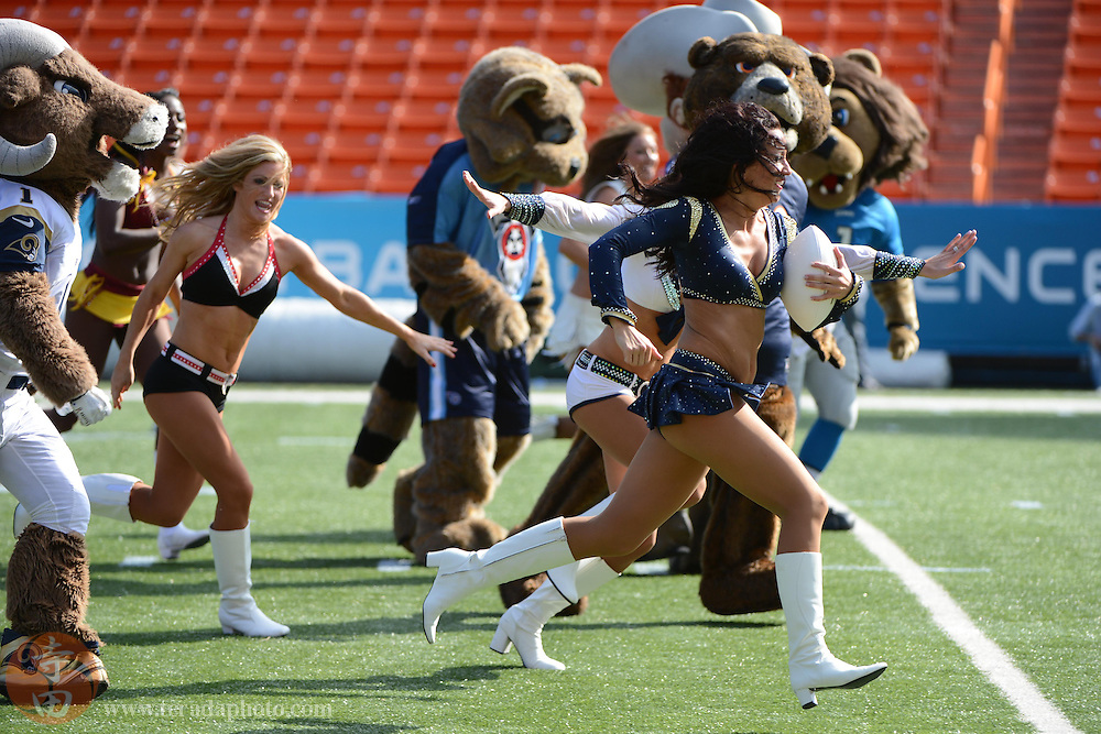 January 26, 2013; Honolulu, HI, USA; St. Louis Rams cheerleader Michelle Love runs the football after catching a pass during a game between the NFL cheerleaders and the NFL mascots on Ohana Day at the 2013 Pro Bowl.