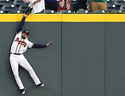 ATLANTA, GA - APRIL 18:  Centerfielder Ender Inciarte #11 of the Atlanta Braves catches a ball over the outfield wall to rob a home run from Philadelphia Phillies left fielder Scott Kingery #4 (not pictured) during the game at SunTrust Park on April 18, 2018 in Atlanta, Georgia.  (Photo by Mike Zarrilli/Getty Images)