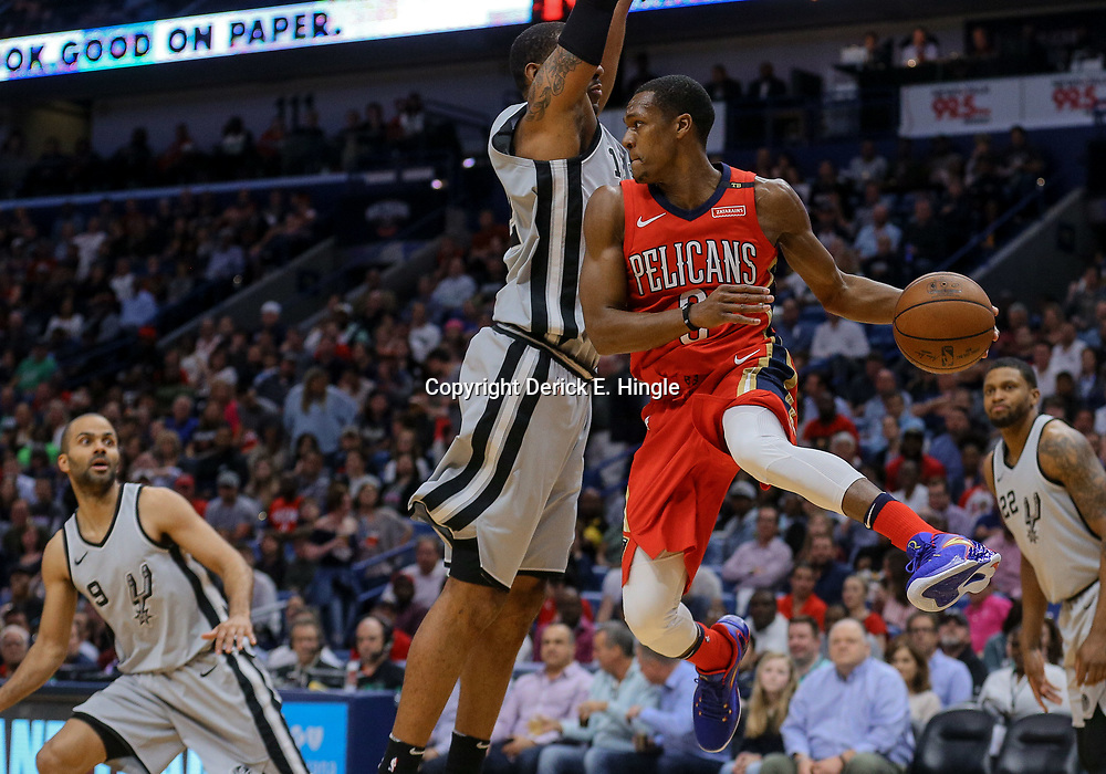 Apr 11, 2018; New Orleans, LA, USA; New Orleans Pelicans guard Rajon Rondo (9) passes as San Antonio Spurs forward LaMarcus Aldridge (12) defends during the first quarter at the Smoothie King Center. Mandatory Credit: Derick E. Hingle-USA TODAY Sports