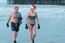 "© Licensed to London News Pictures. 25/12/2014. Brighton, UK. Members of the Brighton and Hove Swimming Club take part in their yearly Christmas day swim despite council officials ""closing"" the beach around the pier to prevent people going in the sea due to health and safety fears. Photo credit : Hugo Michiels/LNP"