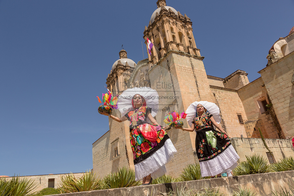 Traditional costumed Istmo dancers folk dancers outside the Santo Domingo church during the Day of the Dead Festival known in spanish as Día de Muertos on October 26, 2014 in Oaxaca, Mexico.