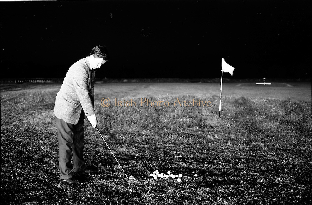 14/05/1965<br /> 05/14/1965<br /> 14 May 1965<br /> New Golf Range at Leopardstown, Foxrock, Dublin. Image shows golfer chipping on the putting green at night under lights.