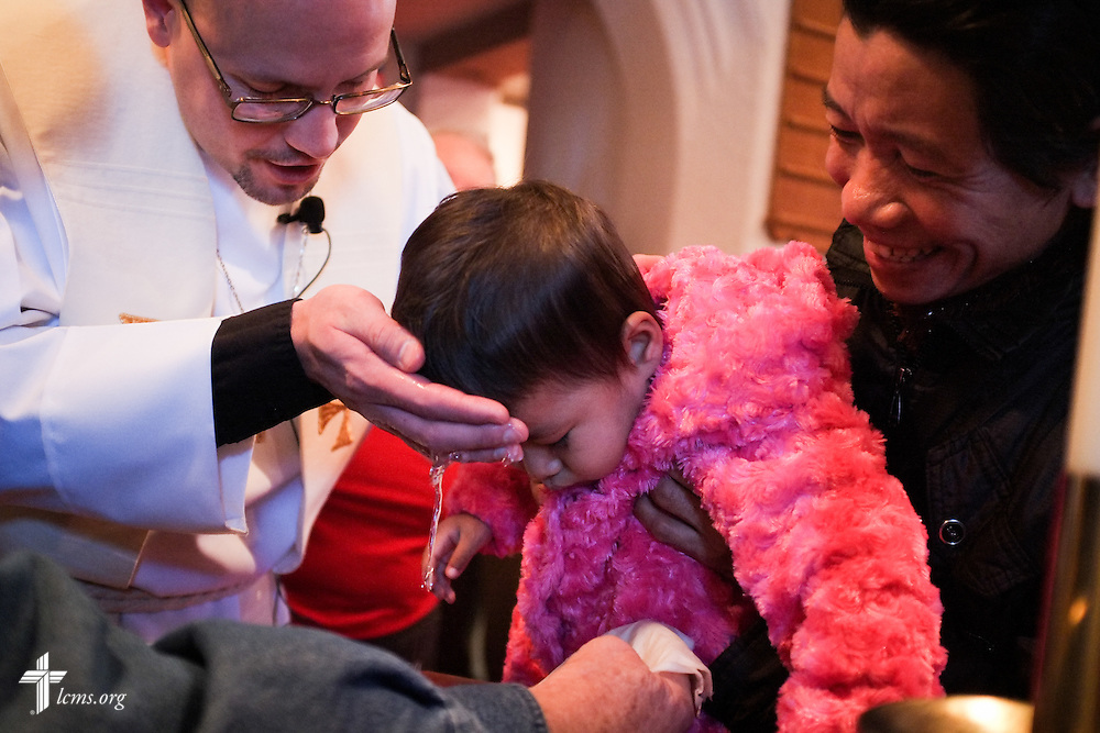 The Rev. Matthew Clark baptizes 21 Nepali immigrants, including Shresti Gurung, on Sunday, Jan. 12, 2014, at Ascension Lutheran Church in St. Louis, Mo. LCMS Communications/Erik M. Lunsford